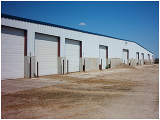 Picture 5. Front view of an 18-row LPCV barn.